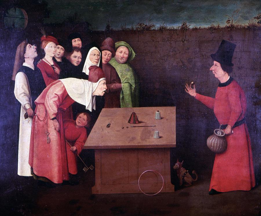 Velho tai silmänkääntäjä esiintyy yleisölle, jonka taskuista varkaat vievät rahapusseja. Hieronymous Bosch / Wikimedia Commons.